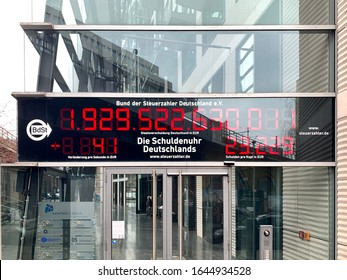 Berlin, Germany - Feburay 2020: clock indicates the actual debt of Germany. (german: Schuldenuhr) The alliance of taxpayer (german: Bund deutscher Steuerzahler) make that debt clock public.