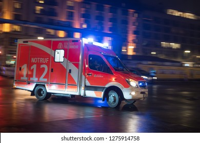 BERLIN, GERMANY - JANUARY 1, 2019: Fire brigade drives on streets crossing during New Year Eve  celebrations.