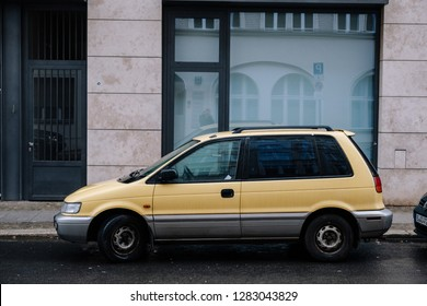 Berlin, Germany - January 12th 2019: Mitsubishi Space Runner first generation in two colour body-paint - yellow and grey. Also called: Dodge Colt Wagon, Eagle Summit Wagon, Plymouth Colt Vista Wagon