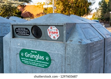 Berlin, Germany - January 22, 2019: Glass container from the Berlin recycling company on the roadside with stickers describing the rules for use.