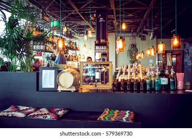 Berlin, Germany - January 23, 2017: Popular rooftop Monkey bar interior in Berlin, Germany. Guests and waiters around. Toned image.