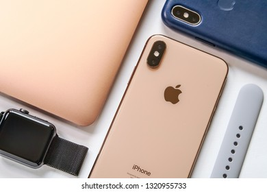 BERLIN, GERMANY - January 27., 2019: Electronic devices- computer, tablet, iphone and smart watch from company Apple. Iphone, Iwatch, Macbook Air, Ipad. Technology mock up