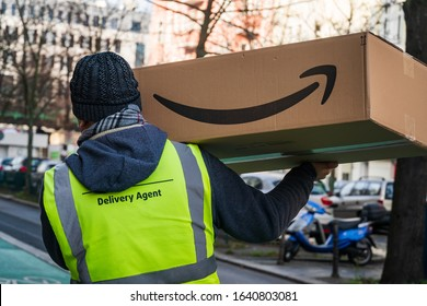 Berlin, Germany - January 27, 2020: Amazon Prime delivery agent during his work shift. Amazon is an American electronic online commerce company