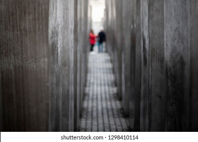 Berlin, Germany - January 27th, 2019: International Holocaust Remembrance Day. People wander through The Memorial to the Murdered Jews of Europe, also known as the Holocaust Memorial.
