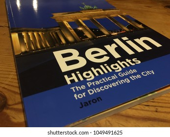 Berlin, Germany - January 31, 2018: Cover of the book entitled Berlin Highlights: The Practical Guide for Discovering the City, written by Clemens Beeck and Günter Schneider, edited by Jaron
