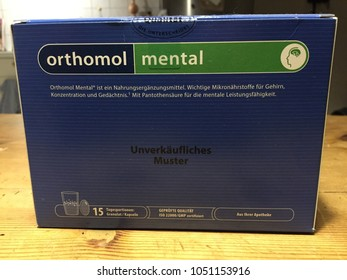 Berlin, Germany - January 31, 2018: Orthomol Mental capsules, food supplement that contains important micronutrients for the brain, concentration and memory
