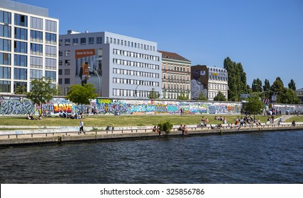 Berlin, Germany - July 02, 2015: The East Side Gallery, one of the last remaining pieces of the original Berlin Wall, stretches for 1.3 km along Muhlenstrasse