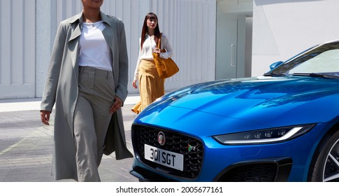 Berlin, Germany - July 10,2021: A blue Jaguar F-Type R Coupe is parked in courtyard