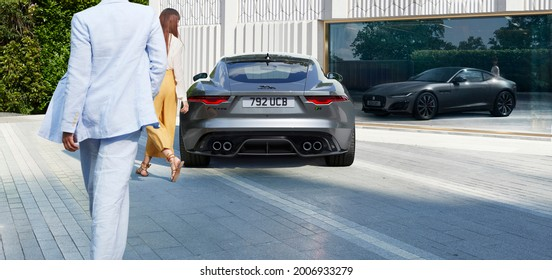 Berlin, Germany - July 10,2021: A grey Jaguar F-Type R Coupe is parked in courtyard
