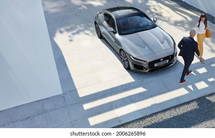 Berlin, Germany - July 10,2021: A silver Jaguar F-Type R Coupe is parked in courtyard