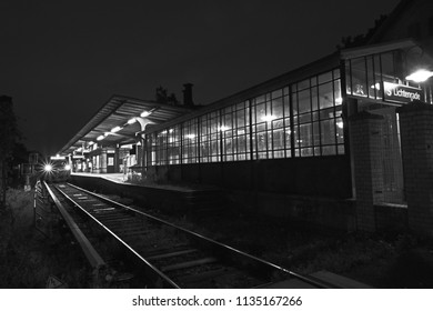 Berlin, Germany - July 12, 2018: Black and white photo from a night scene of an old Berlin S-Bahn station in the district of Lichtenrade