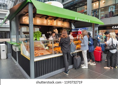 BERLIN, GERMANY - JULY 13, 2018: Unrecognized people buy pastries in Brezelkonig bakery stall on Central Passenger Railway Station or Hauptbahnhof.