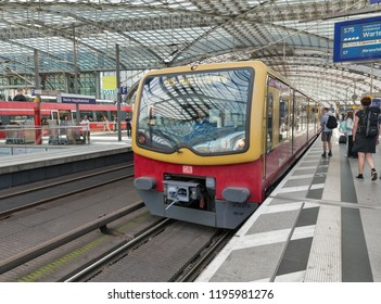 BERLIN, GERMANY - JULY 13, 2018: DB passenger train just arrived to platform of the Central Passenger Railway Station Hauptbahnhof. Station was opened in May 2006, operated by DB Station and Service.