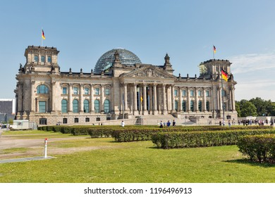 BERLIN, GERMANY - JULY 13, 2018: People visit the Reichstag or Bundestag building, seat of the German Parliament. Berlin is the capital and largest city of Germany by both area and population.