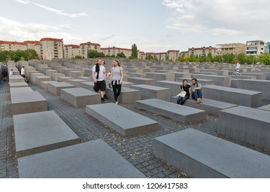 BERLIN, GERMANY - JULY 13, 2018: People visit Memorial to the Murdered Jews of Europe, victims of the Holocaust. The idea belongs to the Berlin publicist Lea Rosh.
