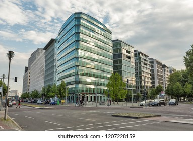 BERLIN, GERMANY - JULY 13, 2018: City street with modern office buildings. Berlin is the capital and largest city of Germany by both area and population.