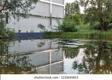 BERLIN, GERMANY - JULY 13, 2018: Piano Lake shore in front of German Society for International Cooperation building close to Potsdamer Platz. Berlin is the capital and largest city of Germany.