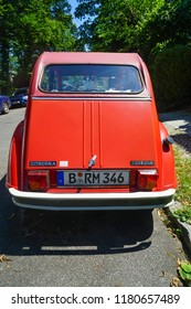 BERLIN, GERMANY - JULY 14, 2018: rear view of Red vintage Citroen 2cv6 car stand on street