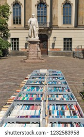 BERLIN, GERMANY - JULY 14, 2018: Used books on sale of a flee market in front of the Humboldt University. It was established by F. William III on the initiative of Wilhelm von Humboldt in 1809.