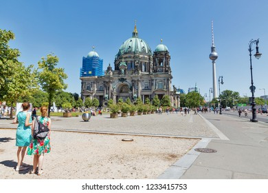 BERLIN, GERMANY - JULY 14, 2018: Tourists visit Berliner Dom icathedral at sunny summer day. Berlin is the capital and German largest city by both area and population.
