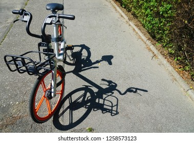 """BERLIN, GERMANY - JULY 14, 2018: rental by application """"ofo"""" and """"mobike"""" brand bicycle parking at the street"""
