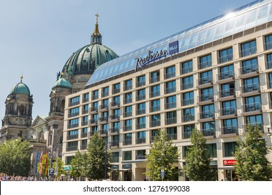 BERLIN, GERMANY - JULY 14, 2018: Radisson Blu hotel facade and Berliner Dome Cathedral in the background. Berlin is the capital and German largest city.