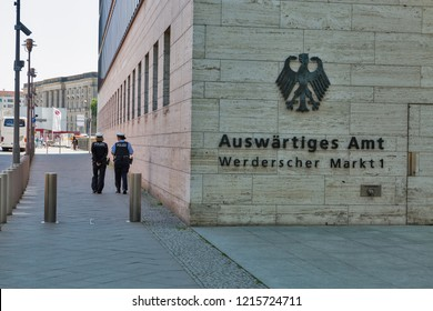 BERLIN, GERMANY - JULY 14,2018: Women police patrol the street and Ministry of Foreign Affair in downtown. Berlin is the capital and German largest city by both area and population.