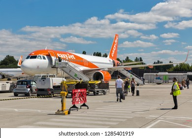 BERLIN, GERMANY - JULY 15, 2018: Passengers depart at EasyJet Airbus A320-214 at Tegel airport. EasyJet Airline Company is a British low-cost carrier airline headquartered at London Luton Airport.