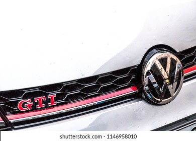 Berlin, Germany - July 16, 2018: Vw Volkswagen Motor Company emblem on an old white GTI vintage car. Volkswagen Group is a German automobile manufacturing group based in Wolfsburg
