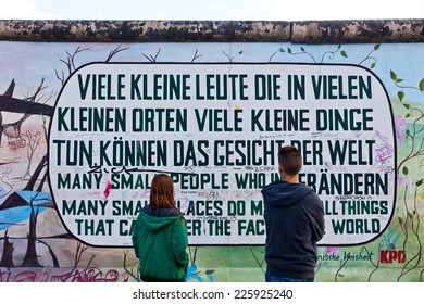 BERLIN, GERMANY - JULY 2, 2014: Fragment of East Side Gallery in Berlin. It's a 1.3 km long part of original Berlin Wall which collapsed in 1989 and now is the largest world graffiti gallery