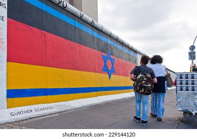 BERLIN, GERMANY - JULY 2, 2014: East Side Gallery in Berlin. It's a part of original Berlin Wall. Nowadays world celebrates the 25th anniversary of Fall of the Berlin Wall, which collapsed in 1989