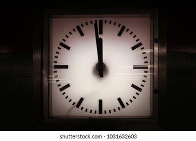 Berlin, Germany - July 2, 2018: Vintage clock showing almost midnight in Kreuzberg in Berlin, Germany.