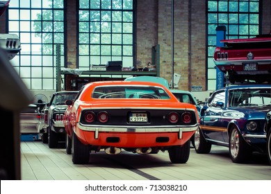 BERLIN, GERMANY - July 2017: Oldtimer Garage with Plymouth Barracuda and Ford Mustang