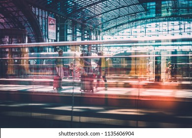 Berlin, Germany - july 2017: Traveling people with luggage at train station platform at  main station (Hauptbahnhof)   in Berlin, Germany