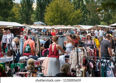 Berlin, Germany - july 2018: Girls looking for clothes and fashion on crowded flea market ( Mauerpark Flohmarkt) in Berlin , Germany