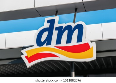 BERLIN, GERMANY JULY 2019: Logo of dm store. dm-drogerie markt is a chain of retail stores that sells cosmetics, healthcare and health food.
