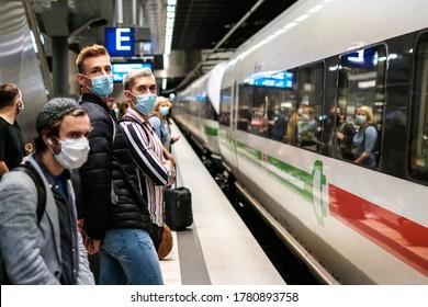 Berlin, Germany - July, 2020: People wearing mask waiting for ICE train on platform at station( Berlin Hauptbahnhof)
