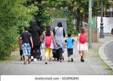 Berlin / Germany - July 22, 2017: Extended family with a migration background on a street in Berlin, Germany