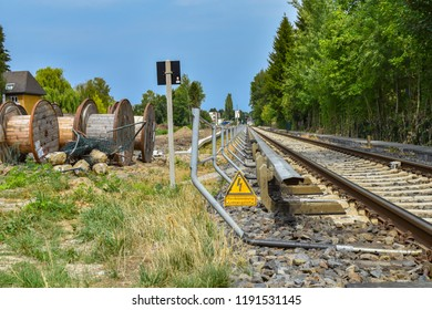 """Berlin, Germany - July 22, 2018: Construction area as preparation for the broadening railroad line for the rail connection between Berlin and Dresden, Germany. Sign: German for """"high voltage"""""""