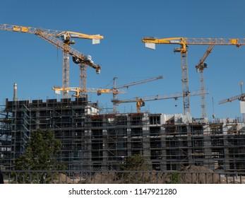 Berlin, Germany - July 23, 2018: Zechbau tower cranes among under construction buildings