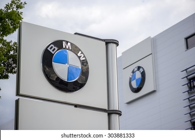 "BERLIN, GERMANY - July 23: the logo of the brand ""BMW"" at a new car dealer building on Jul 23 2015 in Berlin, Germany, Europe, BMW is a German automobile, motorcycle and engine manufacturing company."