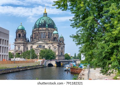 BERLIN, GERMANY - JULY 24, 2016: City Cathedral along Spree river in summer. Berlin attracts 20 million people annually.