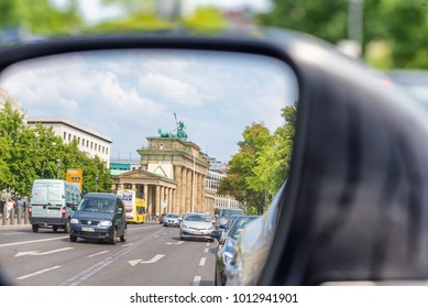 BERLIN, GERMANY - JULY 24, 2016:City traffic as seen from car side mirror. Berlin attracts 20 million people annually.
