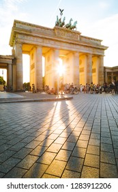BERLIN, GERMANY - July 27, 2015: Beautiful view of famous Brandenburg Gate, one of the best-known landmarks and national symbols of Germany, in beautiful golden evening light, Berlin, Germany.