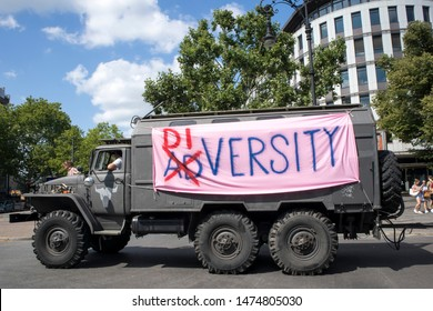BERLIN, GERMANY - JULY 27, 2019: Gay pride, or Christopher Street Day, in Berlin with a portrait of a gay, straight, queer, bisexual or binary person who wants to express freedom, liberty and love.