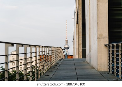 Berlin, Germany - July 28, 2019: Bridge over Spree River across Marie-Elisabeth-Luders-Haus and Paul Lobe Haus buildings in Government District of Berlin. Fernsehturm Telcommunication tower on