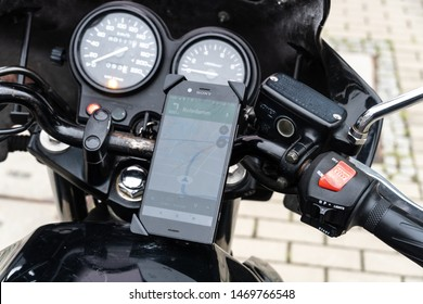 Berlin, Germany - July 30, 2019: Finding a location on maps using the mobile gps navigation on a Sony smartphone