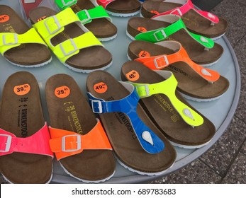 Berlin, Germany - July 31, 2017: Birkenstock sandals displayed in shoe store. The company is a famous German brand of sandals and other shoes notable for their contoured cork and rubber footbeds