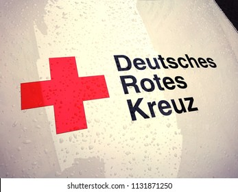 Berlin, Germany - July 5, 2018: Symbol of the German Red Cross (Deutsches Rotes Kreuz). The German Red Cross, or the DRK, is the national Red Cross Society in Germany offering a wide range of services