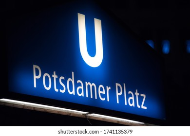 Berlin, Germany - July 6, 2017: Potsdamer Platz U-Bahn station sign at night. The U Bahn, or Untergrundbahn (underground railway) is situated underneath the Potsdamer Platz in central Berlin